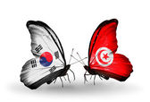 Two butterflies with flags on wings as symbol of relations South Korea and Tunisia — Stockfoto