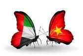 两只蝴蝶与符号的关系阿拉伯联合酋长国和越南的翅膀上的标志 — 图库照片