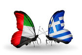 Two butterflies with flags on wings as symbol of relations UAE and Greece — Stock Photo
