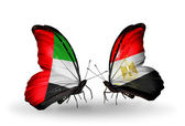 Two butterflies with flags on wings as symbol of relations UAE and Egypt — Stock Photo