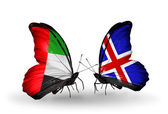 Two butterflies with flags on wings as symbol of relations UAE and Iceland — Stock Photo