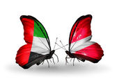 Two butterflies with flags on wings as symbol of relations UAE and Latvia — Stockfoto