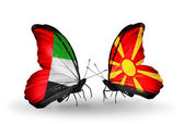Two butterflies with flags on wings as symbol of relations UAE and Macedonia — Zdjęcie stockowe