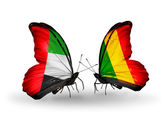 Two butterflies with flags on wings as symbol of relations UAE and Mali — Stock Photo