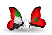 Two butterflies with flags on wings as symbol of relations UAE and Morocco — Stock Photo
