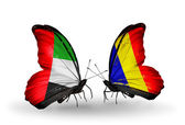 Two butterflies with flags on wings as symbol of relations UAE and Chad, Romania — Stock Photo
