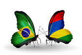 Two butterflies with flags on wings as symbol of relations Brazil and Mauritius — Stock Photo