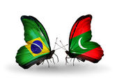 Two butterflies with flags on wings as symbol of relations Brazil and Maldives — Stock Photo