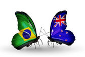 Two butterflies with flags on wings as symbol of relations Brazil and New Zealand — Stock Photo