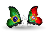 Two butterflies with flags on wings as symbol of relations Brazil and Portugal — Stock Photo
