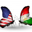 Two butterflies with flags on wings as symbol of relations  and Tajikistan — Photo