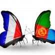 Two butterflies with flags on wings as symbol of relations France and Eritrea — Stock Photo