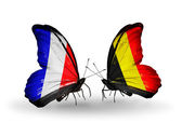 Two butterflies with flags on wings as symbol of relations France and Belgium — Stock Photo