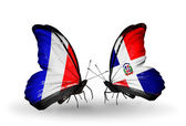Two butterflies with flags on wings as symbol of relations France and Dominicana — Stock Photo