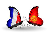 Two butterflies with flags on wings as symbol of relations France and Kirghiz — Stock Photo