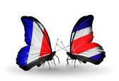 Två fjärilar med flaggor på vingarna som symbol för förbindelserna mellan frankrike och costa rica — Stockfoto