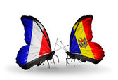 Two butterflies with flags on wings as symbol of relations France and Moldova — Stock Photo