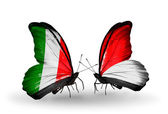 Two butterflies with flags on wings as symbol of relations Italy and Monaco, Indonesia — Stockfoto