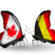 Two butterflies with flags on wings as symbol of relations Canada and Belgium — Stock Photo