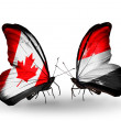 Two butterflies with flags on wings as symbol of relations Canada and Yemen — Stockfoto