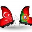 Two butterflies with flags on wings as symbol of relations Turkey and Portugal — Stockfoto