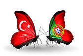 Two butterflies with flags on wings as symbol of relations Turkey and Portugal — Stock Photo