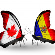 Two butterflies with flags on wings as symbol of relations Canada and Moldova — Stock Photo