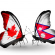 Two butterflies with flags on wings as symbol of relations Canada and Nepal — Stockfoto