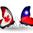 Two butterflies with flags on wings as symbol of relations Canada and Taiwan — ストック写真