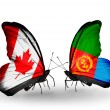 Two butterflies with flags on wings as symbol of relations Canada and Eritrea — Stock Photo