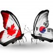 Two butterflies with flags on wings as symbol of relations Canada and South Korea — Stock Photo