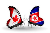 Two butterflies with flags on wings as symbol of relations Canada and North Korea — Stock Photo