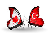Two butterflies with flags on wings as symbol of relations Canada and Turkey — Stockfoto