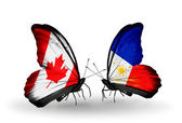 Two butterflies with flags on wings as symbol of relations Canada and Philippines — Stock Photo