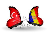 Two butterflies with flags on wings as symbol of relations Turkey and Andorra — Stock Photo