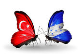 Two butterflies with flags on wings as symbol of relations Turkey and Honduras — Stock Photo