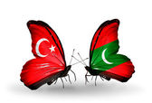 Two butterflies with flags on wings as symbol of relations Turkey and Maldives — Stock Photo