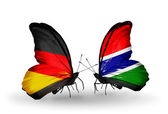 Two butterflies with flags on wings as symbol of relations Germany and Gambia — Stock Photo