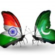 Two butterflies with flags on wings as symbol of relations India and Pakistan — Stock Photo