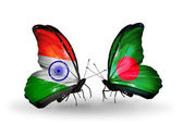 Two butterflies with flags on wings as symbol of relations India and Bangladesh — Stock Photo