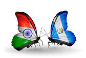 Two butterflies with flags on wings as symbol of relations India and Guatemala — Stock Photo