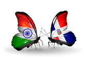 Two butterflies with flags on wings as symbol of relations India and Dominicana — Stock Photo