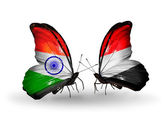 Two butterflies with flags on wings as symbol of relations India and Yemen — Stock Photo
