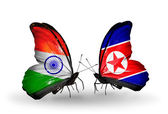 Two butterflies with flags on wings as symbol of relations India and North Korea — Stock Photo