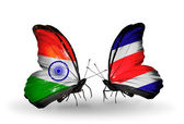Two butterflies with flags on wings as symbol of relations India and Costa Rica — Foto de Stock