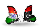 Two butterflies with flags on wings as symbol of relations India and Libya — Stock Photo