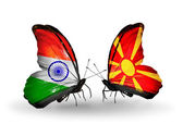 Two butterflies with flags on wings as symbol of relations India and Macedonia — Stock Photo