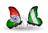 Two butterflies with flags on wings as symbol of relations India and Nigeria — Stock Photo