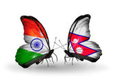 Two butterflies with flags on wings as symbol of relations India and Nepal — Stock Photo