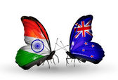 Two butterflies with flags on wings as symbol of relations India and New Zealand — Stock Photo